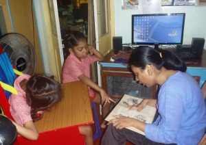 Barnani reading to Kalpana and Ganga from her frvorite story book.