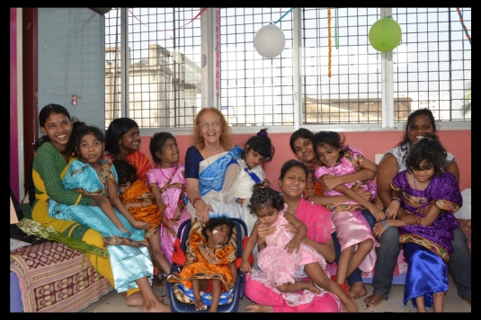 A picture of all the girls of Shishur Sevay and Dr. Harrison on her birthday