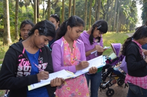 Girls taking notes at the botanical gardens.